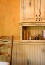 Pisces sign: small, plain light wood kitchen